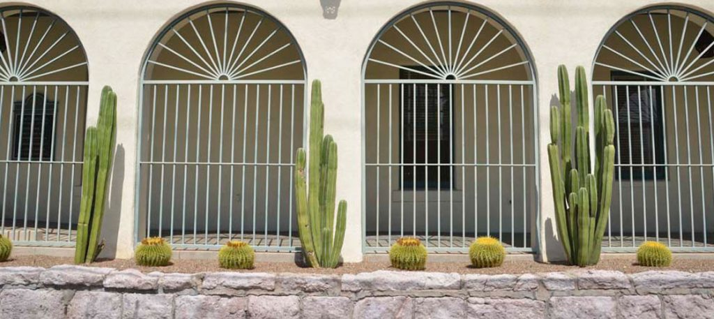 These sculptural plants create a vertical element in a Mid-Mod way. Don't block the arches!